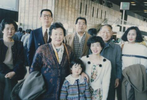 Tasaki family photo taken in Toyko, Narita Airport before Takanobu Tasaki's departure to Chicago. Depicted left to right: Fumiko Nakano, Takanobu Tasaki, Etsuki Tasaki, Hidenobu Tasaki, Seiko Tasaki, Shigueru Tasaki, and Mari Tasaki. Aya Tasaki is the young girl in the front.