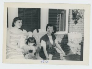 Victoria Moy, Ellyn Chan, and Sophia Chan relaxing on their patio in Forest Hills, 1950.