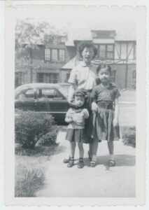 Sophia Chan posing with her daughter Andrea and Ellyn Chan in Forest Hills, 1954.